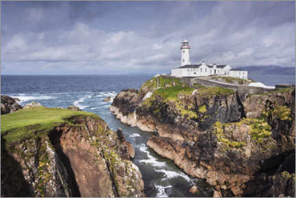 Canvas print  Lighthouse on rocks by the sea with clouds - The Wandering Soul