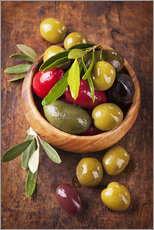 Muursticker  Bowl with olives on a wooden table - Elena Schweitzer