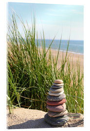 Acrylglas print  A tower of stones on a dune at the sea - Buellom