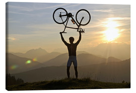 Canvas print  Man holding a racing bike above his head