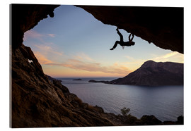Acrylglas print  Climber in a cave at sunset