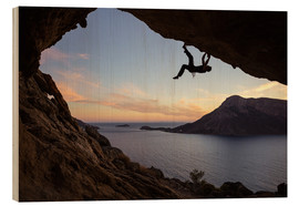 Hout print  Climber in a cave at sunset