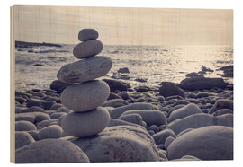 Hout print  Pyramid of pebbles on the sea front - Elena Schweitzer